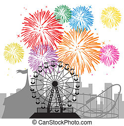 fireworks and silhouettes of a city and amusement park -...