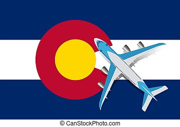 Vector Illustration of a passenger plane flying over the Colorado flag.