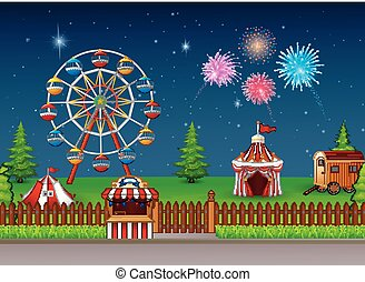 Amusement park landscape at night with fireworks