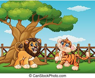 Animals lion and tiger beside a tree inside the fence