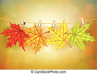 Autumn leafs with clothespins