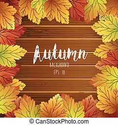 Autumn leaves frame on wood