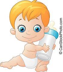 baby boy holding milk bottle
