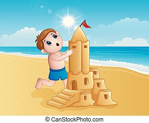 Boy making a big sand castle at the beach
