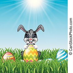 Cartoon bunny holding Easter eggs in the grass