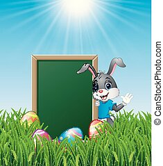 Cartoon bunny waving hand with Easter eggs and green chalkboard in the grass