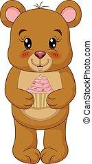 Cartoon cute teddy bear holding a cupcake