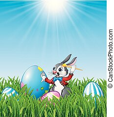 Cartoon Easter bunny painting Easter eggs in the grass