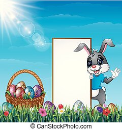 Cartoon Easter bunny with a basket of easter eggs and blank sign in the grass field