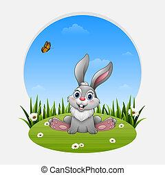 Cartoon funny rabbit sitting on the grass