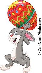 Cartoon rabbit carrying Easter egg - Vector illustration of...