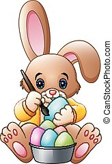 Cartoon rabbit painting an eggs