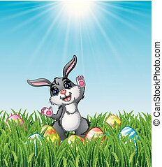 Cartoon rabbit with Easter eggs in the grass