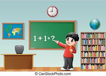 Cartoon school boy at blackboard in a classroom