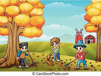 Children raking leaves in the farmyard during fall season