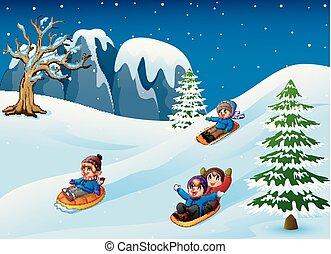 Children sledding in snow downhill