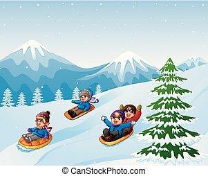 Children sledding snow downhill