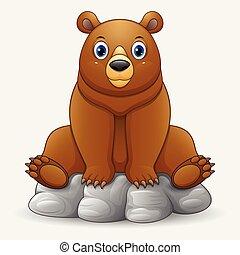 Cute baby bear cartoon sitting on rock