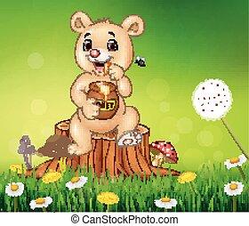 Cute baby bear holding honey