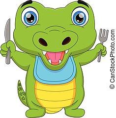 cute baby crocodile holding cutlery