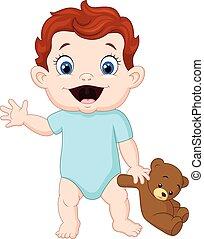 Cute baby holding a teddy bear