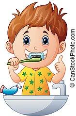 Cute boy brushing teeth