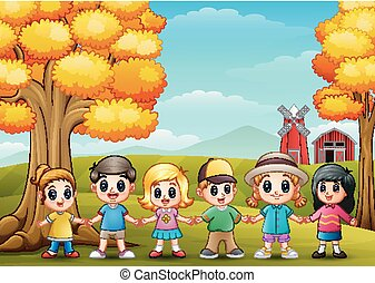 Cute children holding hands together in farm background