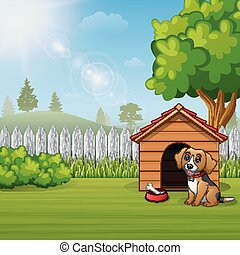 Cute dog sitting in front of a kennel in a garden