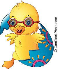 Cute Easter duckling in a broken eggshell