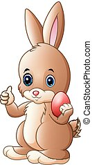 Cute little bunny giving a thumb up with holding red easter egg