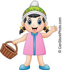 Cute little girl holding a basket