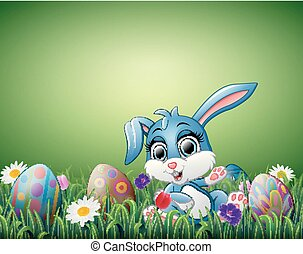 Cute little rabbit cartoon with decorated Easter eggs in a field
