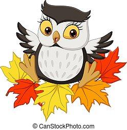 Cute owl cartoon sitting on autumn leaves