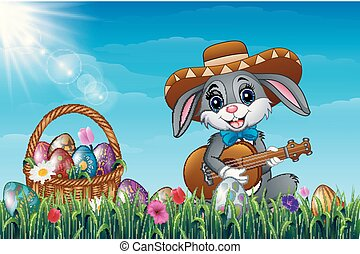Easter bunny with a basket full of decorated Easter eggs in a field. Cartoon rabbit playing guitar in the garden with wearing a sombrero