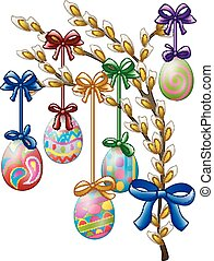 Easter eggs decorated hanging on a tree branch