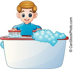 Happy boy cleaning bathtub on a white background