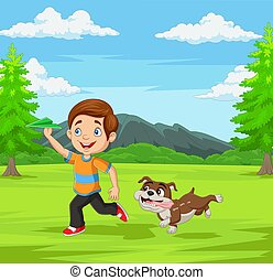 Happy boy playing paper airplane with his pet in the park
