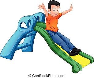 happy boy playing slide