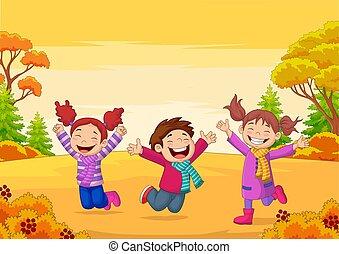 Happy children jumping on autumn background