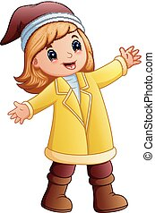 Happy girl in yellow winter clothes