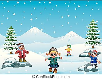 Happy kids playing outdoors in winter
