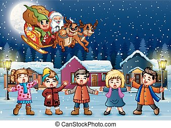 Happy kids singing with Santa Claus and elf riding his sleigh at the winter night