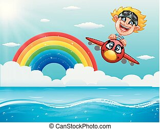 Happy little boy riding a plane above the ocean