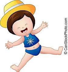 Happy little girl in blue swimsuit jump
