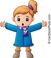 Happy little girl in blue winter clothes