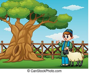 Happy Muslim kid with a sheep beside a tree inside the fence