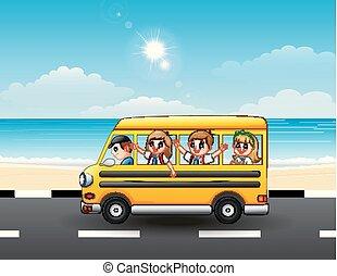 Happy school kids riding a school bus on the seaside street