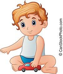 Little boy playing toy car