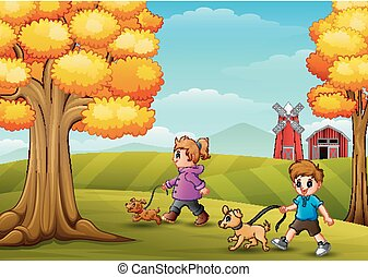 Little girl and boy walking with his dogs in farm background