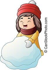 Little happy girl making a snowman